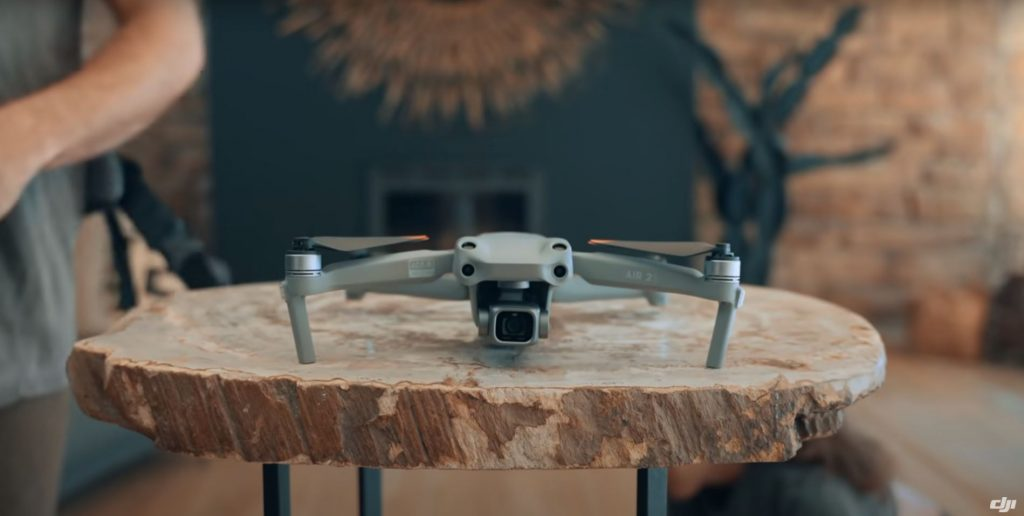 DJI Air 2S sitting on a slice of tree trunk.