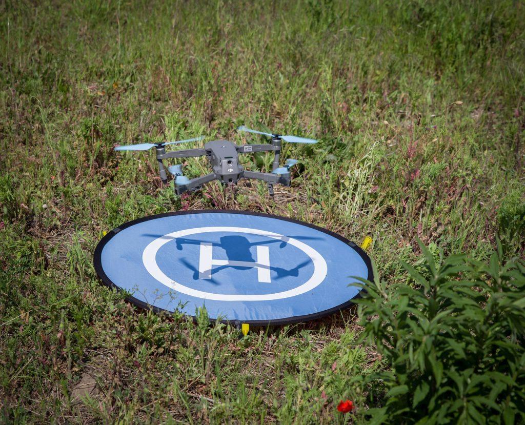 Expert Drone Pilot - Drone Landing On A Landing Pad In A Field