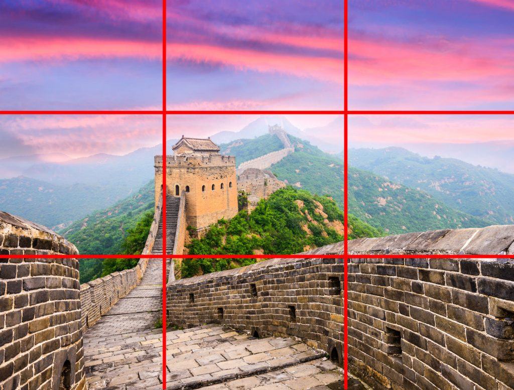 A photo from atop the Great Wall of China demonstrating the rule of thirds, with grid-lines shown over the image.